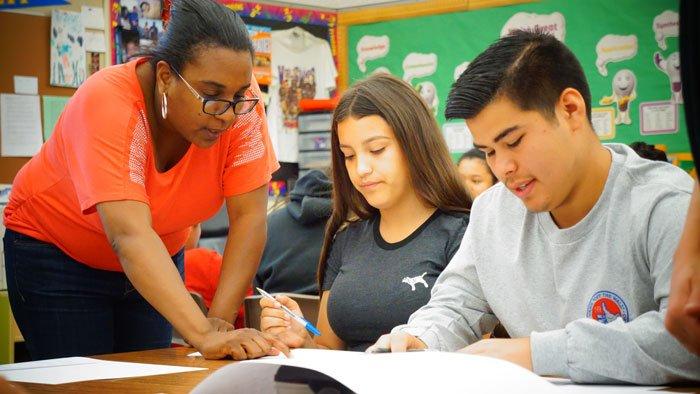 math teacher working with high school students
